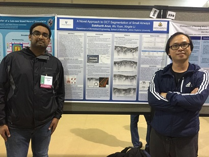 Sidd (left) Presenting at Hopkins Undergraduate Research Day
